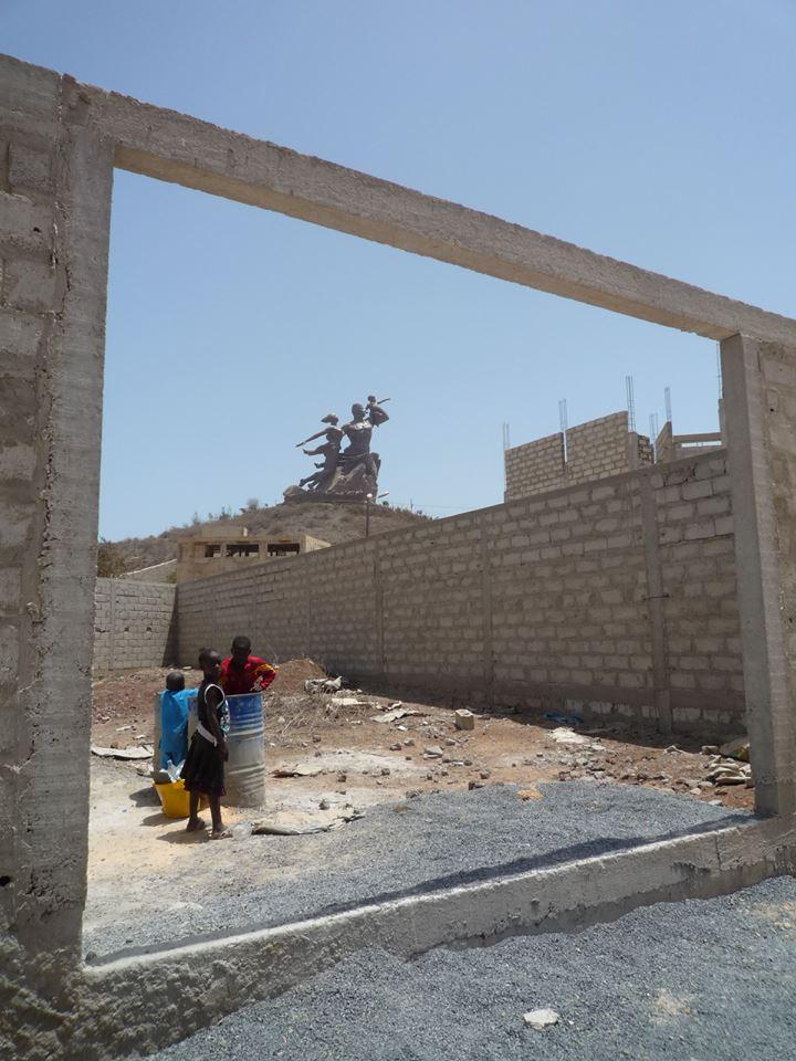 A building under construction in Ouakam and the Monument de la Renaissance Africaine